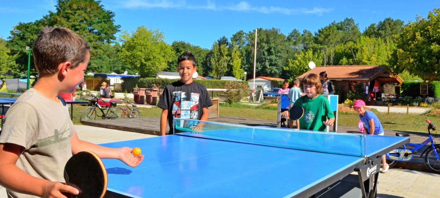 Children at the table tennis tables